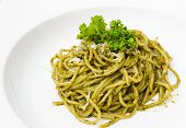 stock photo of pesto sauce  - Italian pasta spaghetti with pesto sauce and basil leaf - JPG
