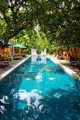 long swimming pool on balinese spa resort