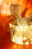 natty present box in warm golden colors