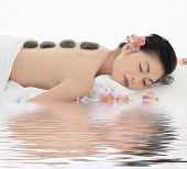 foto of asian woman  - A beautiful and sexy Asian woman being pampered at a spa - JPG