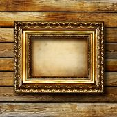 antique gilded frame over wooden wall