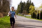 foto of pick up  - This photo captures a cute little boy picking up litter on the side of a road - JPG