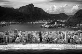 stock photo of ipanema  - Aerial view of buildings on the beach front with a mountain range in the background Ipanema Beach Rio De Janeiro Brazil