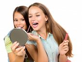 Teenage Girls Applying Make up and Looking in the Mirror. Pretty Teens Having Fun and Putting Makeup