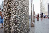 BERLIN - July 23: Parts of Berlin Wall on Potsdamer Platz with chewing gums stuck to it on July 23,