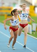 BARCELONA - JULY, 14: M. Curylo(L) and P. Wyciszkiewicz(R) of Poland competes on 4X400 Relay of the 20th World Junior Athletics Championships at the Olympic Stadium on July 14, 2012 in Barcelona,Spain