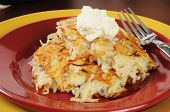 Potato Latkes Topped With Sour Cream