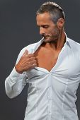 foto of open shirt breast showing  - white shirt on a manly man isolated - JPG