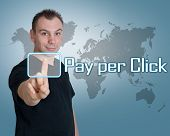 stock photo of payment methods  - Young man press digital Pay per Click button on interface in front of him - JPG