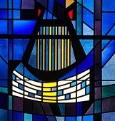 Stained glass window of harp and musical scale