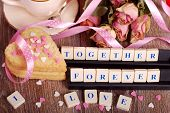 foto of scrabble  - love words made of scrabble letters dried roses and heart shaped cookies with sprinkles for valentine on wooden table - JPG