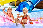 image of inflatable slide  - Child on water slide at aquapark - JPG