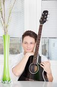 Man With Guitar At Home