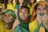 pic of enthusiastic  - Astonished group of Brazilian sport soccer fans looking at the screen - JPG