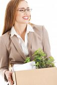 stock photo of box-end  - Beautiful business woman holding box with office items - JPG