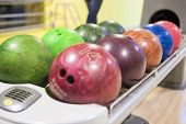 Closeup Of Plenty Bowling Balls In One Line