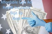 A Genuine Doctor points to the Affordable Care Act Health Insurance Sign Up Here text as he puts on