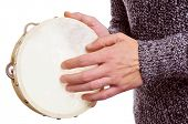 someone playing a tambourine over a white background