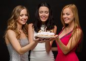 celebration, food, friends, bachelorette party and birthday concept - three smiling women holding ca