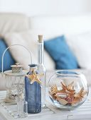 stock photo of starfish  - Idea of interior decoration with starfishes and glass bottles - JPG