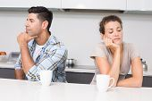 image of not talking  - Unhappy couple having coffee not talking at home in kitchen - JPG