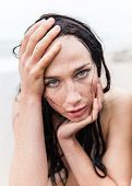 stock photo of seminude  - Portrait of frozen wet seminude young woman on cold sea background - JPG