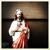 stock photo of sacred heart jesus  - weathered statue of Jesus in the instagram style - JPG
