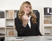 Businesswoman Making A Rude Gesture