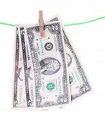 Dollar bills hanging on rope attached with clothes pins. Money-laundering concept. Isolated on white