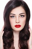 Portrait of young beautiful woman with stylish make-up and long curly hair