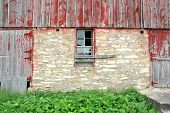 Old Abandoned Barn With Broken Window And Two Wood Doors