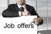 Businessman Pointing On Sign  Job Offers