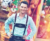 stock photo of lederhosen  - Young man posing in traditional Bavarian Lederhosen - JPG
