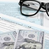 Usa Tax Form 1040 With Glasses, Calculator And 100 Us Dollar Bills