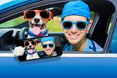 stock photo of car-window  - dog in a car looking through window with Driving instructor taking a selfie - JPG