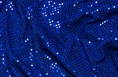 Wrinkled Blue Sequined Fabric Background