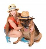 Beautiful young girl with dog isolated on white
