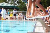 stock photo of swim meet  - On the starting blocks at the beginning of a  race - JPG