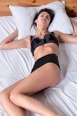 Beautiful Young Multi Racial Woman Sleeping In Bed