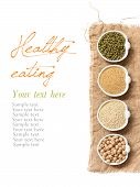 Raw Organic Amaranth And Quinoa Grains, Chickpea And Mung Beans In Small Bowls