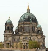 Cathedral building in Berlin. Riverside view from the boat on Spree river.