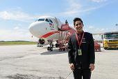 KUALA-LUMPUR - MAY 06: Airasia crew member on May 06, 2014 in Kuala-Lumpur, Malaysia. AirAsia Berhad
