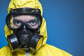 image of gas mask  - A scientist wearing a biological suit during an outbreak - JPG