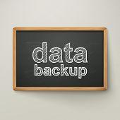 Data Backup On Blackboard In Wooden Frame