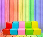 Many Color Sofa In Colorful Wood Room