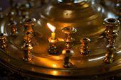 stock photo of church interior  - Burning candles in a Russian ortodox church - JPG
