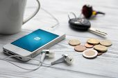 WROCLAW, POLAND - JULY 31, 2014: Photo of iPhone 4 smartphone device with Linkedin app running - a s