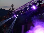 Abstract Blue Bright Spotlights In Open Air Stage