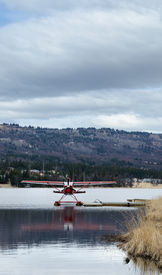picture of float-plane  - A sea plane tied up to a floating dock