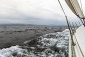 Sailing in cloudy weather. Yachting. Luxury yachts.